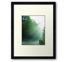 Into the light. Framed Print