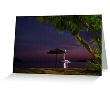 Anchored sailing boat illuminated at dusk Greeting Card