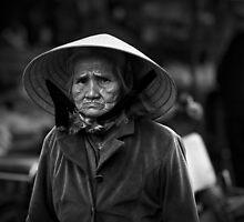 Vietnam - Portrait of elderly woman at markets in Dalat by Chris Bishop