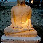 Buddha glowing on beach. by Amanda Gazidis