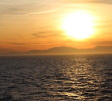 Sunset over the ocean by TheBlueline