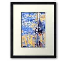 Rusted blue and yellow door Framed Print
