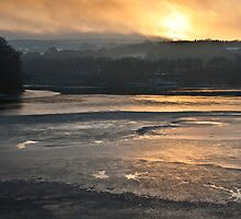Sunset over a frozen reservoir by Shaun Whiteman
