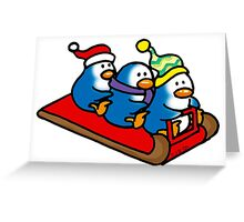 3 winter penguins on a sledge Greeting Card