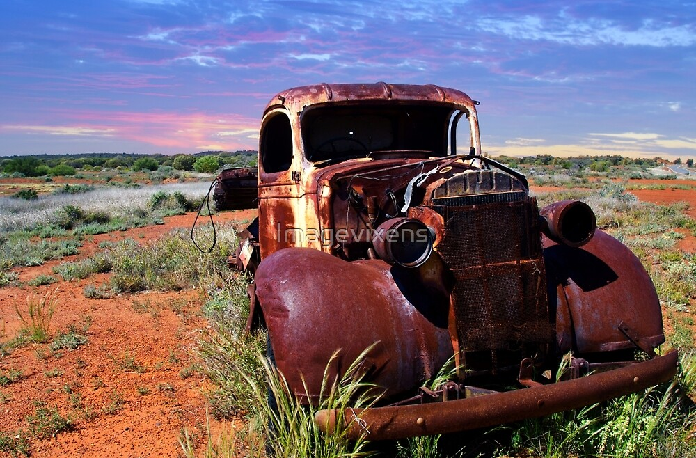 A rusty old pick-up truck in a field by Imagevixens