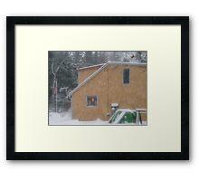 Kitchen Light in Snowstorm Framed Print