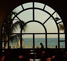 Reading by the window by Tony Blakie