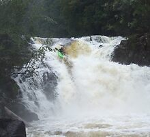 Kayaker on Arm River falls in flood by Patrick Reid
