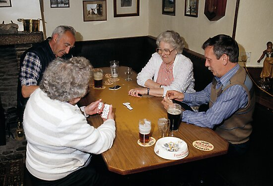Game of dominoes in English pub, UK, 1985. by David A. L. Davies