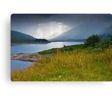 Scottish landscape with grey clouds Canvas Print