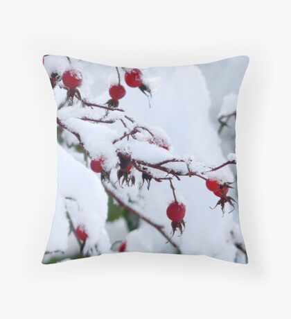 rosehips in snow Throw Pillow