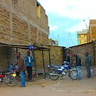 Local guys at sunset in Nairobi, KENYA by Atanas NASKO