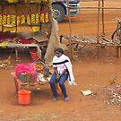 Local woman selling tomatoes on Mombasa Road, KENYA by Atanas NASKO