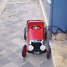 little red pedal car by BronReid