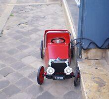 little red pedal car by BronReid
