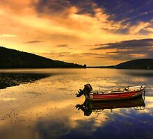 Red boat,Blue sky,Yellow Clouds. by Tania Koleska