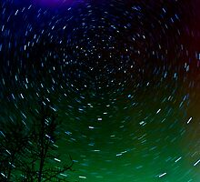 Star  Trails with the Northern Lights by peaceofthenorth