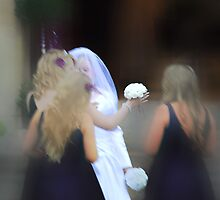 Fussing over the bride, before she makes her walk. by Kerensa Davies