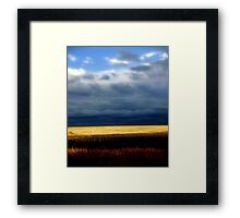 A stormy day over golden wheat Fields Framed Print