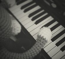 cat playing piano by hellohappy