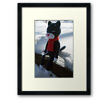 cat in the snow Framed Print