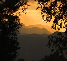 Front Range of the Rockies at Sunset...Colorado Springs by dfrahm
