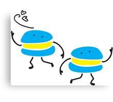 Funny dancing macarons Canvas Print