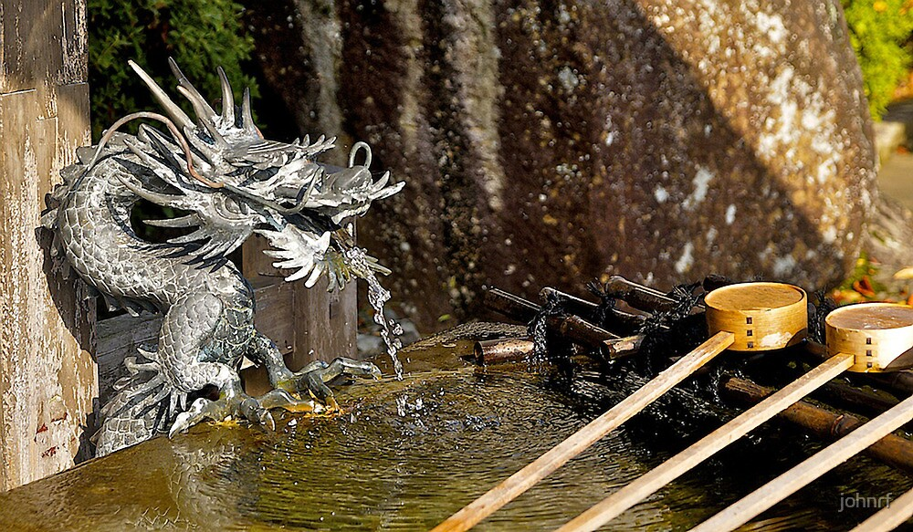 Japanese temple, water dragon, water fountain.  by johnrf
