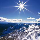 Sunburst over Mt Feathertop and Mt Jaithmathang by Travis Easton