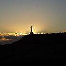 Cross in sunset on Llanddwyn Island by nellie11