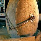 Grain Grinding Wheel. Woolmers Estate, Longford, Tasmania. by Philip Hallam