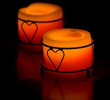 burning candles in the darkness by panyukova
