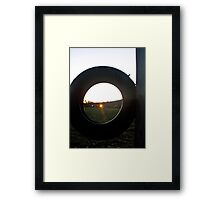 Evening Light Through a Tire Framed Print