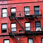 Red Building, Black Windows by Maren Misner