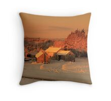 Warm colours at farm buildings on a winter morning.  Throw Pillow