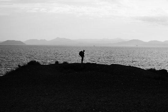 Silhouette and the ocean by Mattias Olsson