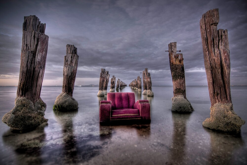 an old chair and an even older pier by Glen Barton