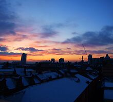 Across snowy rooftops. by Mbland