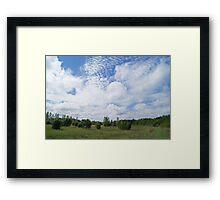 Rolling clouds over plains Framed Print