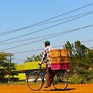 Man on a bicycle in Nairobi, KENYA by Atanas NASKO