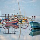 Boats Mirrored on the Water at Sanur by JohnKarmouche