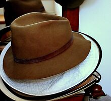 Hat Stacking On The Rack by Michael May