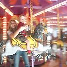 Mother and Child on Carousel by Regan Hansen