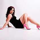 Stephanie in a Short Black Dress and Pink Shoes by JonWHowson