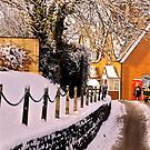 Village 'Main Street' In December Snow by Mike  Waldron