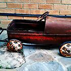 Rusty pedal car by Kristen McLachlan