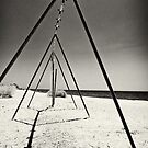 abandoned swing set at salton sea by Flux Photography