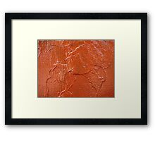 Thick and uneven layer of red paint on a wall closeup Framed Print