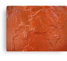 Thick and uneven layer of red paint on a wall closeup Canvas Print