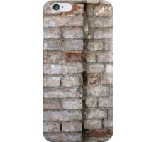 Detail of a wall of an old red brick with white coating iPhone Case/Skin